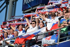 The Slovak team has visible support at tribunes.