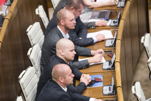 ĽSNS MPs sitting in parliament.