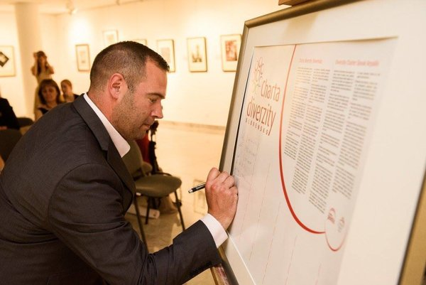 Signing the Diversity Charter.