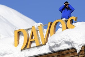 Member of Swiss special police forces stand on the roof of a hotel next to the Congress Centre during the opening day of the the WEF meeting in Davos.