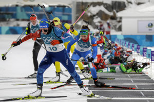 Biathletes leaving the shooting area afetr first round.