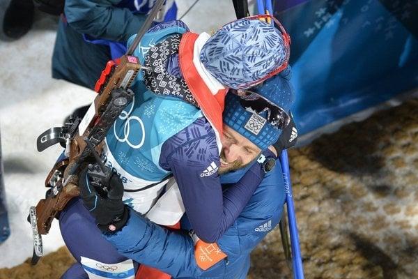 Anastasiya Kuzmina rejoices with her husband Daniel after a mass start biathlon race.