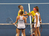 Slovak players Čepelová, Hantuchová (in foregorund) lost to Australian tennis players Stosur (L) and Dellacqua in doubles.