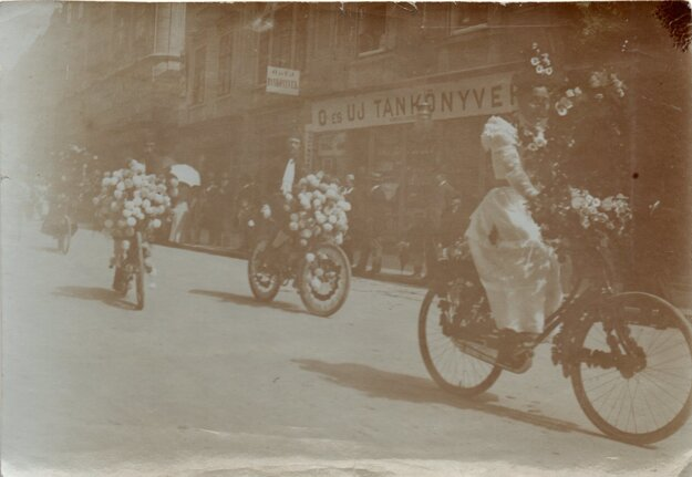 A historical photo of a flower cycling ride in Bratislava