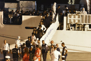 Passengers disembark from the Diciotti ship in Sicily.