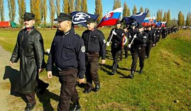 Kotleba (left) marching to the memorial in Šulekovo with Slovak Togetherness supporters in 2005.