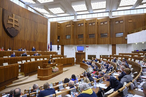 Slovak MPs sit in a parliamentary session.