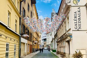 The Bratislava-based Nedbalka Gallery has installed umbrellas above the street where it is seated, creating  Umbrella Street for the third time in its history.