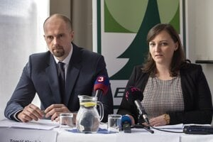 Tomáš Klouček , the then sales director of Forests of the Slovak Republic (Lesy SR) national company, and his colleague Aneta Kšenžigová present a decision to implement a system of the anti-corruption management at Lesy SR on February 25, 2020.