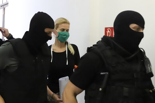 Monika Jankovská (centre) will remain in custody.