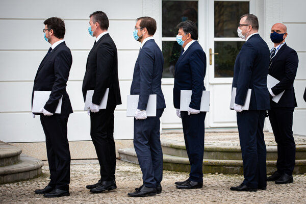 Štefan Holý, first in line, waiting with his fellow soon-to-be ministers to be appointed for their cabinet posts on March 21.