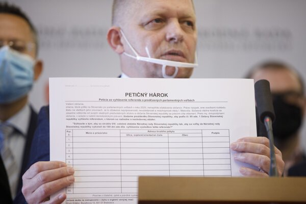 Chair of opposition Smer Robert Fico holds a petition sheet