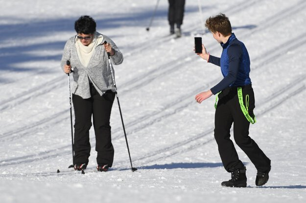 Sport enthusiasts of all ages cross-country ski on the groomed tracks in Štrbské Pleso, High Tatras region, on February 25.