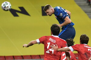 Milan Škriniar (in blue) before scoring the opening goal at the FIFA World Cup 2022 qualifier match in Trnava.