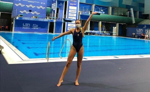 Zora Opalka poses by a pool at this year's European Aquatics Championships, which took place in Hungary in mid-May.