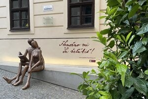 An interactive statue by the Love Bank museum in Banská Štiavnica.