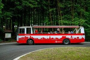 The open-top bus operates between Patrónka and Železná studienka in Bratislava during the summer.