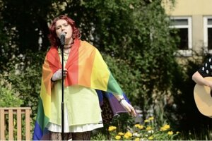 """Wrapped up in a rainbow flag, Slovak singer Karin Ann performs """"babyboy"""" on a national TV broadcaster in Poland."""