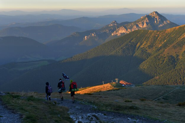 Tourists walk down from the Veľký Kriváň peak.