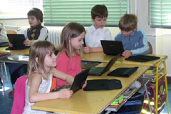 One school has replaced second-graders' paper notebooks with computers.