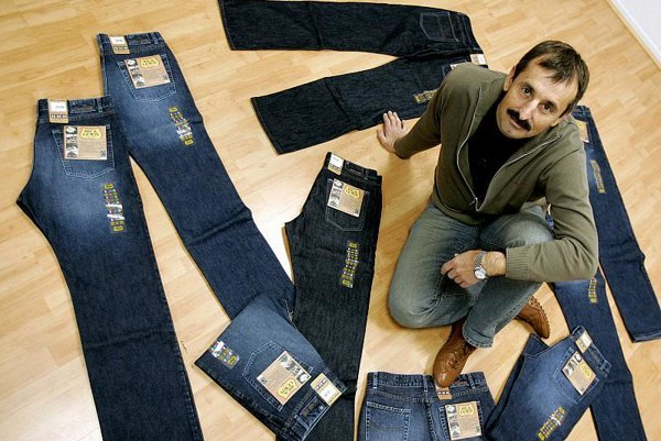 General director of the Rica Lewis jeans showroom, Dominique Lanson, poses with bluejeans of cotton bought from impoverished African growers at well above the market rate are making their debut in Europe. Their French manufacturer, Rica Lewis, billed them as the world's first fair trade jeans in 2006.