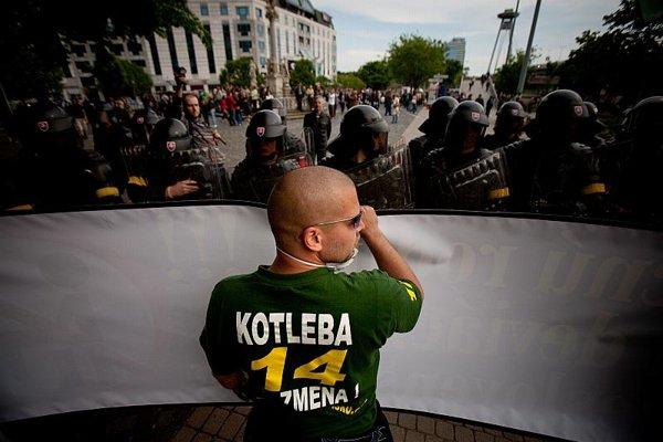 A skinhead faces riot police in central Bratislava.