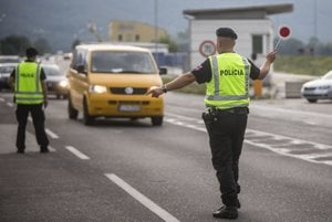 Slovak police checking cars at the border crossing in Berg, Austria.