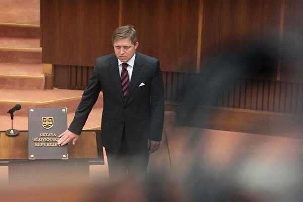 Robert Fico descends from the prime minister's seat back to parliament.