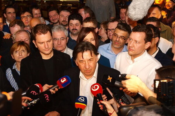 Ján Budaj (C) of OĽaNO with his party colleagues during election night.