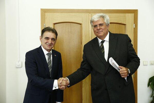 Foreign Ministry State Secretary Igor Slobodník (R) with Sani Dermaku, Serbian Ambassador - illustrative stock photo
