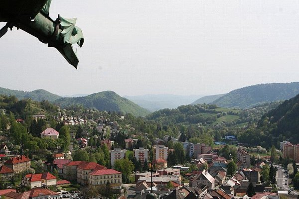 An iron dragon on the castle overlooks the newer part of this former gold-mining town