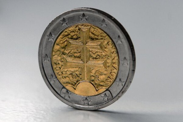 A standard Slovak €2 coin, with cross.