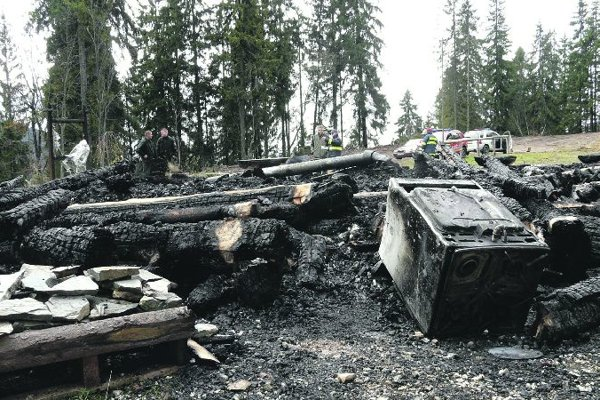 The charred remains of the Burda chalet and information centre.