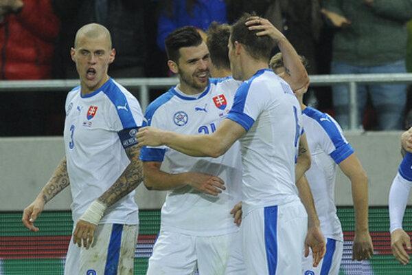 Michjal Ďuriš (C) and Martin Škrtel rejoice after a goal scored against Switzerland.