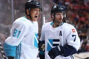 L_R: Marian Hossa celebrates his goal with teammate Mark Streit.