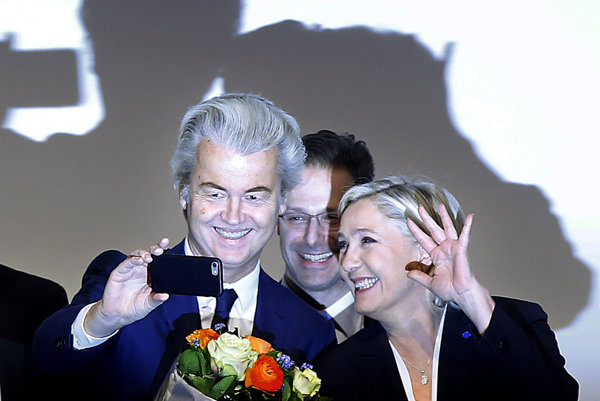 Far-right leader and candidate for next spring presidential elections Marine le Pen from France (r), and Dutch populist anti-Islam lawmaker Geert Wilders (l) stand together after their speeches during a meeting of European Nationalists in Koblenz, Germany, on January 21, 2017.