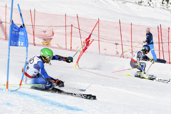 L-R: Slovak Matej Falat compeets against French Mathieu Faivre in St Moritz, February 14.