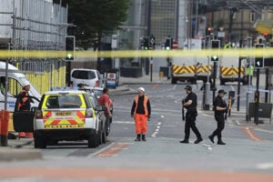 Police guard close to the Manchester Arena in Manchester, Britain, on May 23, 2017, a day after an explosion.