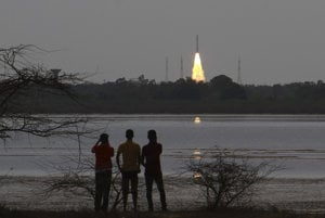 People watch as Indian Polar Satellite Launch Vehicle with 30 co-passenger satellites, including the Slovak skCUBE, blasts off from the Satish Dhawan Space Centre at Sriharikota in Andhra Pradesh, India, on June 23.