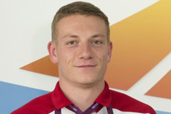Ján Volko poses with his medals after winning gold at European U23 Championship.