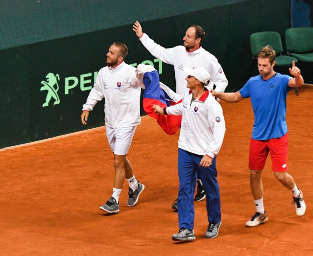 Slovak team (L-R Andrej Martin, Igor Zelenay, Jozef Kovalík and Norbert Gombos) celebrate after the winning match against Poland in Davis Cup.