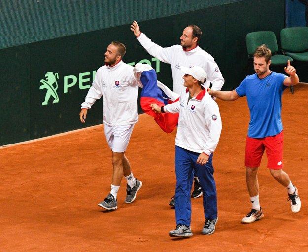 Slovak team (L-R Andrej Martin, Igor Zelenay, Jozef Kovalík and Norbert Gombos) celebrate after the winning match against Poland in Davis Cup.