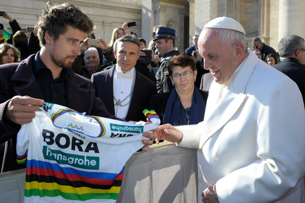 Three-time cycling World champion Peter Sagan presents Pope Francis with a World Champion rainbow jersey, during the pontiff's general audience, in St Peter's Square, at the Vatican.