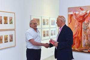 Dušan Kállay (L) turns 70, Vincent Polakovič of Danubiana congratulates.
