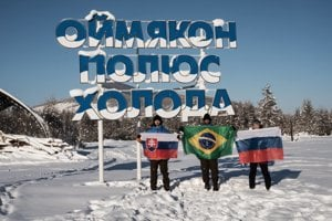 """Dominik Bari and his colleges in front of inscription """"Oymyakon, Pole of Cold"""""""