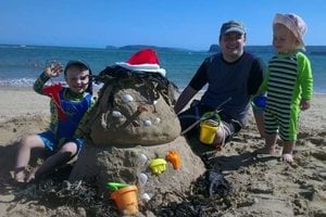 Slovak family in Australia builds a sandman instead of a snowman for Christmas.