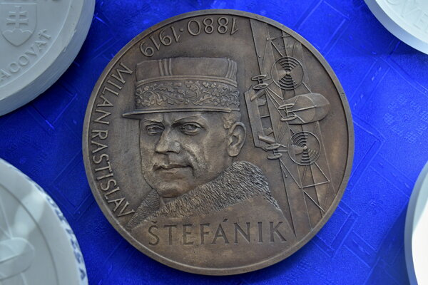 Bronze cast of the collector's coin.