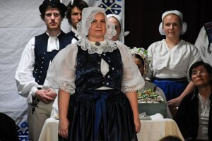 """A traditional  kopanice costume worn by a married woman. The woman wearing such a costume is called """"krojovanka""""."""
