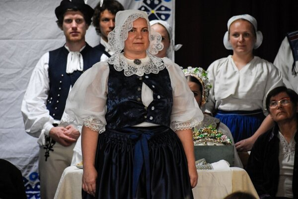 "A traditional  kopanice costume worn by a married woman. The woman wearing such a costume is called ""krojovanka""."