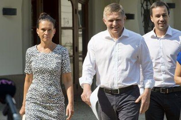 PM Fico (Centre) and his wife Svetlana react to accusation.